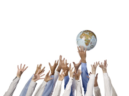 Image of a group of hands reaching the globe against the white background photo