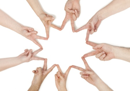 combined effort: Group of hands forming a star shape isolated in a white background