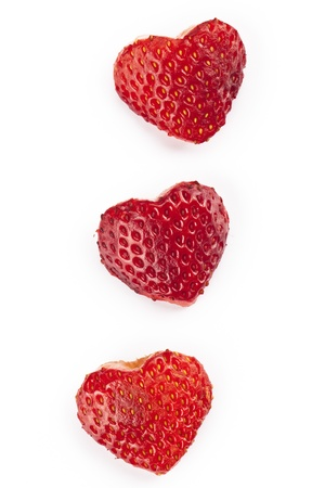 shaped: A row of heart shaped strawberry fruits