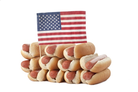 A stack of hotdog sandwiches and American flag isolated on a white surface Stock Photo - 17258646