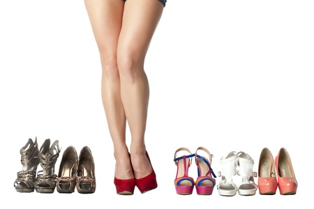 Ladies shoes collection with a woman leg wearing red high heel shoes Stock Photo - 17257960