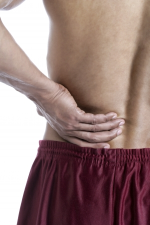 old man on a physical pressure: Close up image of lower back pain against white background Stock Photo