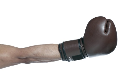 Close up image of male boxer arm wearing boxer gloves against a white background Stock Photo - 17257938