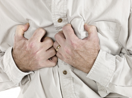 Old man having a chest pain isolated over the white background Stock Photo - 17258748