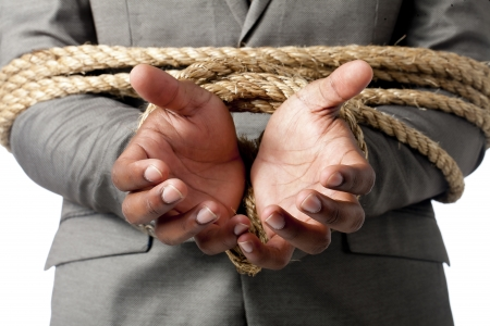 aieron: Businessman tied up with a rope in a macro image