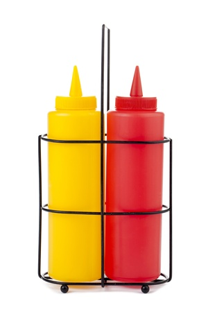 Close-up image of a mustard and catsup bottle isolated on the white background