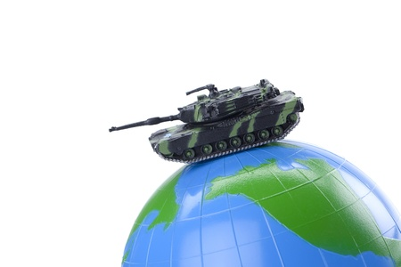Close-up image of a military tank on the globe isolated over the white background photo