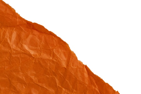 ripped: Close up image of ripped crumple orange paper against white background Stock Photo