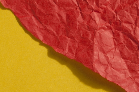 ripped: Close up image of ripped crumple red paper against yellow background Stock Photo