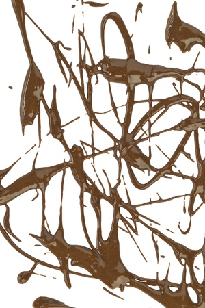 Scattered melted chocolate drip against white background photo