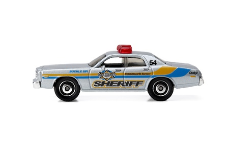 A side view portion of the sheriffs toy car isolated on a white surface photo