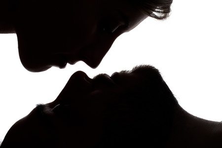 Silhouette image of a sweet couple that were going to kiss