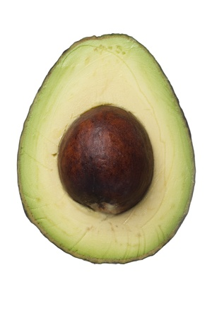 avacado: A nutritional slice of an avocado against white background