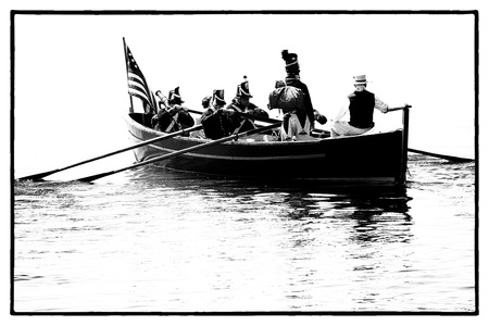 Black and white image of soldiers in the boat from war of 1812 reenactment