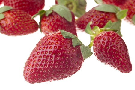 An image of red ripe strawberries over the white background