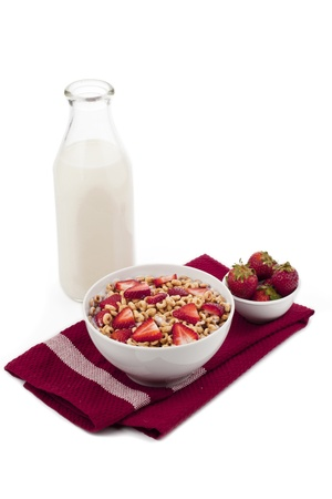 Cereals with strawberries and glass of milk on a white background Stock Photo - 17258213