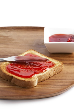 jam sandwich: Illustration of strawberry jam sandwich on a wooden board Stock Photo