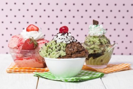 chocolate sprinkles: Three flavors of ice cream on the bowl with different toppings