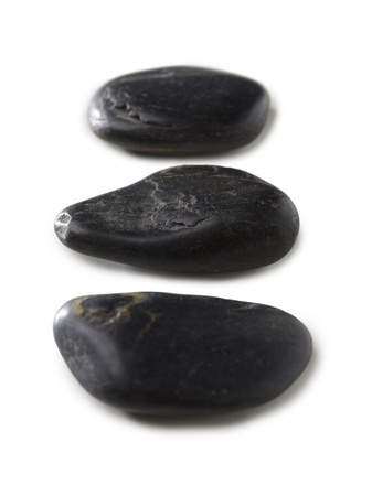 magnetic stones: Close up image of three spa stones against white background