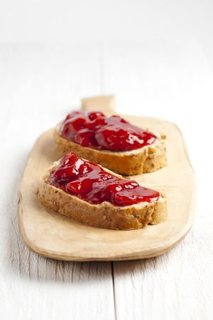Wheat bread with strawberry jam on the wooden plate Stock Photo - 17258276