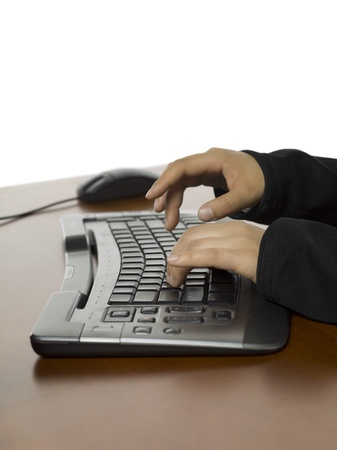 Close-up image of a womans hand typing on the computer keyboard 版權商用圖片