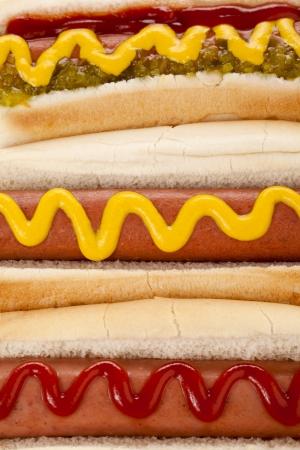 Closed up of three hotdog sandwiches Stock Photo - 17258413