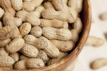 earthnuts: Close up image of peanuts on bowl