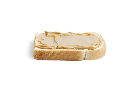 Close up image of peanut butter in bread against white background Stock Photo - 17258136