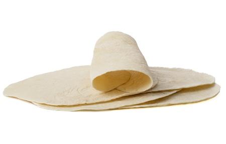 tortilla wrap: Imagen de primer plano de c�scara suave tortilla aislado en una superficie blanca
