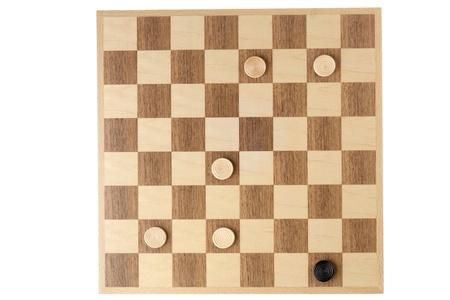 checker board: Imagen Vista superior de las piezas del corrector ortogr�fico en placa contra el fondo blanco
