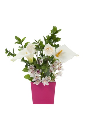 Close-up image of variety of flowers in pink flower vase against white background.