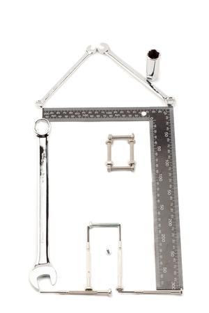 Close-up shot various metallic tools forming a house. Stock Photo - 17258183