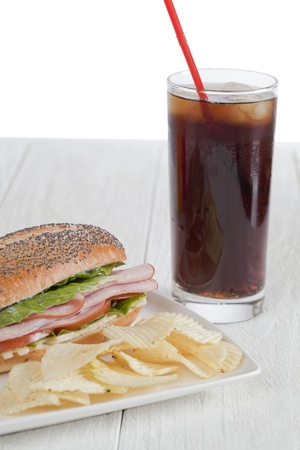 snack: Yummy snack consisting of cola, ham sandwich and chips Stock Photo