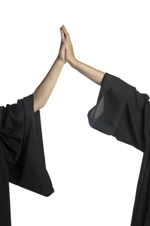 Close up image of graduating student hand doing high five
