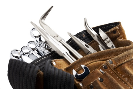 A close-up cropped image of workers belt with construction tools isolated on white Stock Photo - 17258788