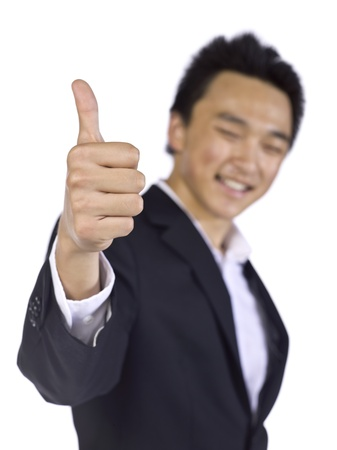 teenage guy: Portrait of teenage guy wearing formal attire in thumbs up gesture against a white background Stock Photo