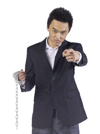 Quarrelsome young man holding a chain while pointing at his enemy Stock Photo - 17288240