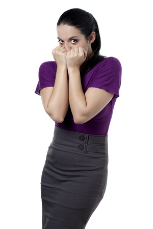 bashfulness: Portrait of shy woman isolated on white background Stock Photo
