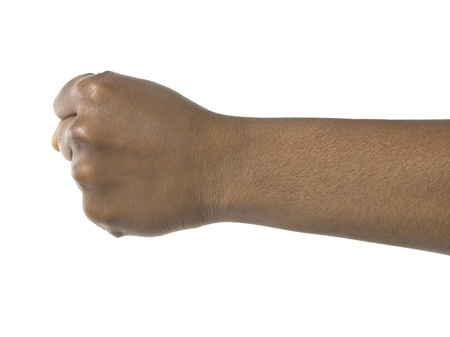 Clenched fist of a black man over a white background photo