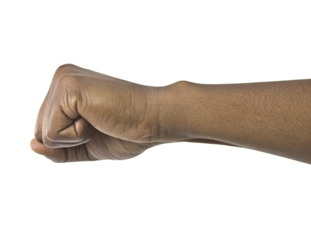 closed fist sign: Close up image of human close fist against white background Stock Photo
