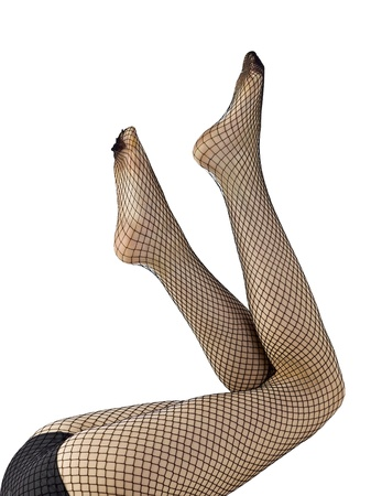 waxed: Close up image of legs of a woman wearing net stockings against white background