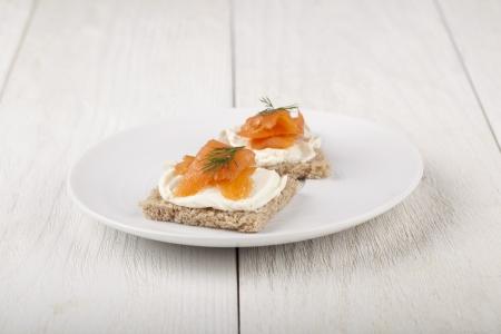 Smoked salmon and cream cheese on mini crackers