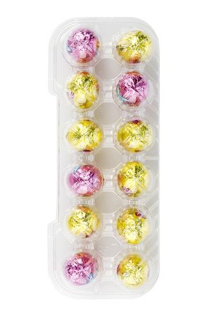 Chocolate Easter eggs in a tray displayed on white background. Stock Photo - 17301850