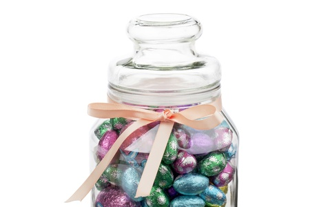 Close-up of Easter eggs in a jar on white. photo
