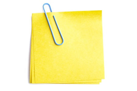 Close-up shot of blue paperclip attached to yellow adhesive note on white. Stock Photo - 17301914