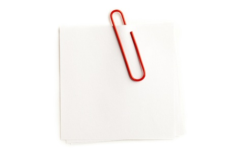 Close-up shot of orange paperclip on blank adhesive note. Stock Photo - 17301655