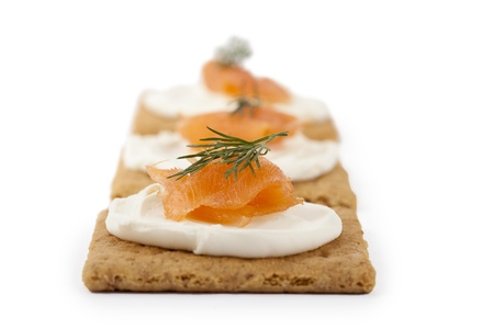 dill leaves: Close-up image of bread with smoked salmon and cream cheese top with dill leaves