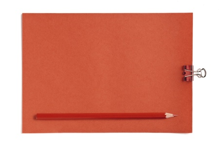Image of orange blank paper with metal clip and pencil photo