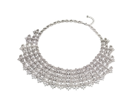 Close-up image of a platinum necklace against the white background