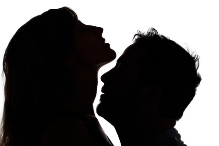 Silhouette of a sensual couple over a white background